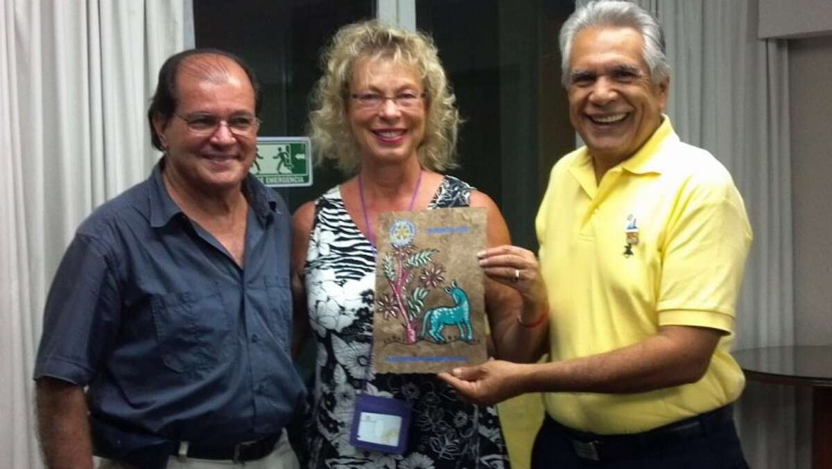 Acapulco Rotarians present Lake Conroe Rotarian Christina Rathbun with a gift while visiting their club.