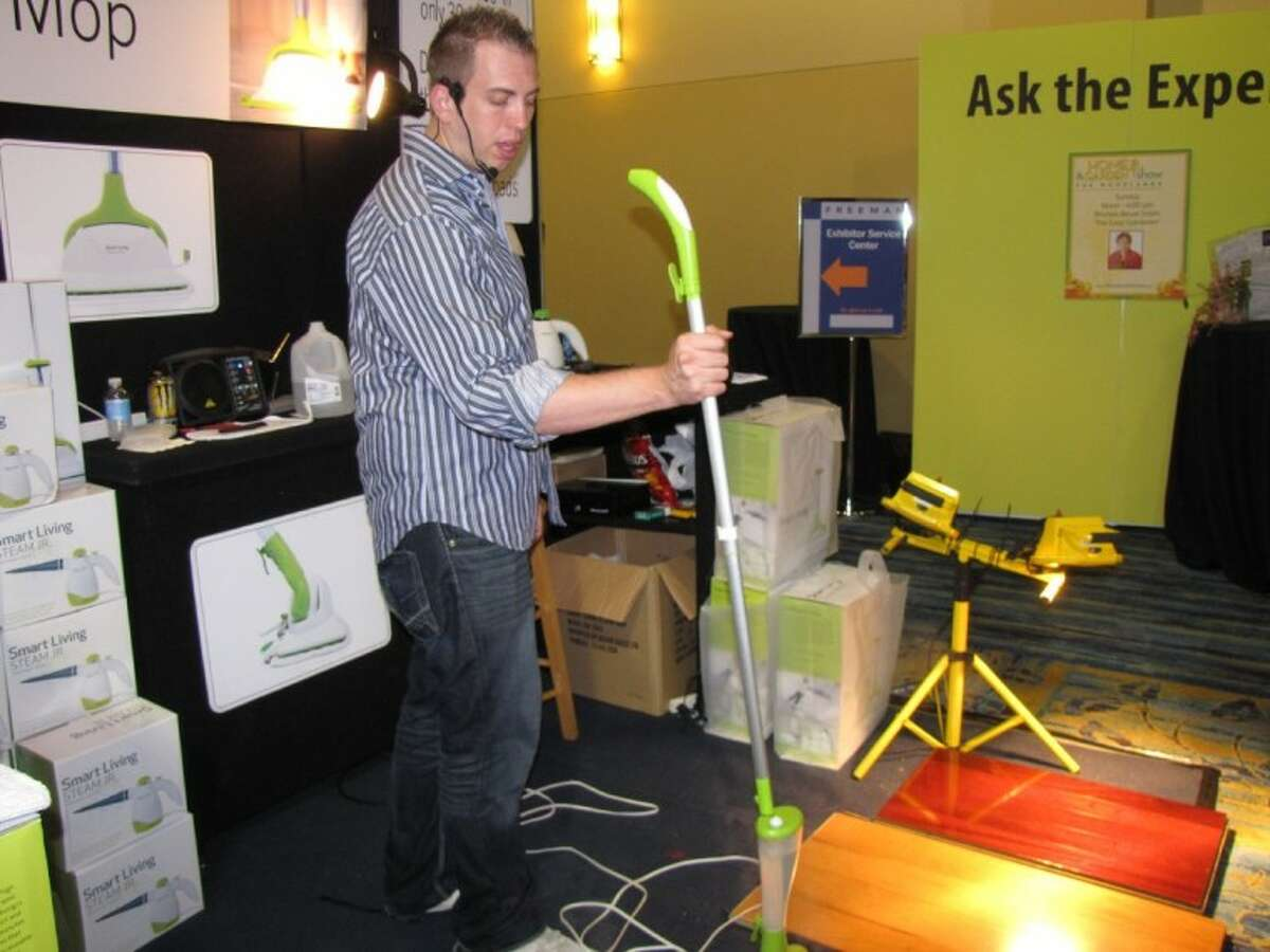 Representatives with Smart Living Steam Mop showed patrons how the product performed at the 10th Annual Fall Home and Garden Show at The Woodlands Waterway Marriott Hotel Sunday.