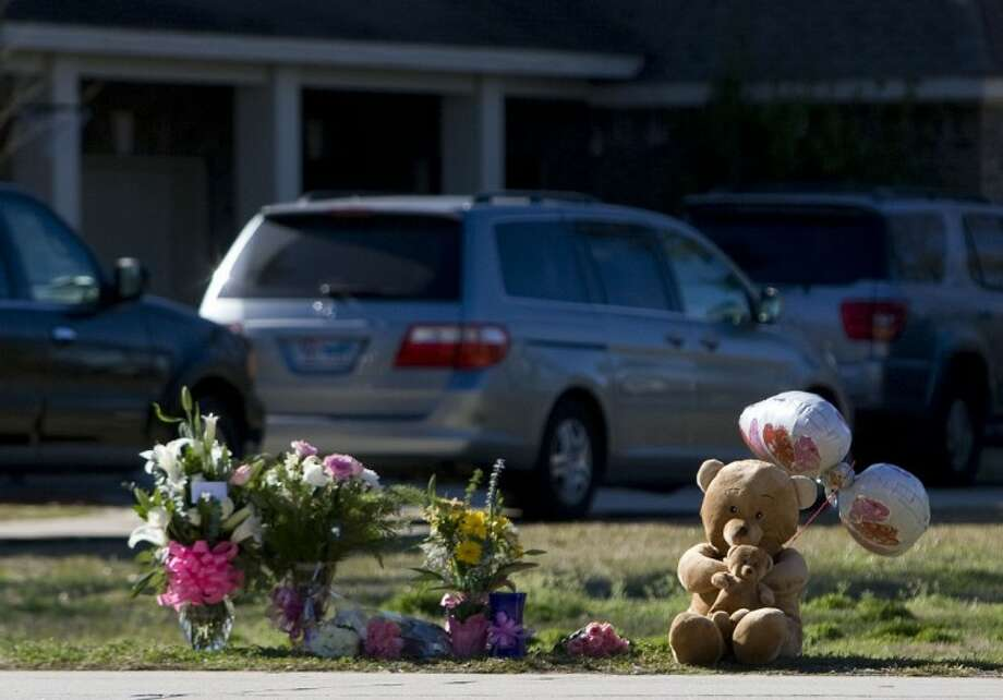 Teddy bears, flowers and balloons are seen at the site where a 3-year-old girl was fatally struck by a vehicle outside her home Monday on East Legends Trail in South Montgomery County. Photo: Staff Photo By Eric S. Swist