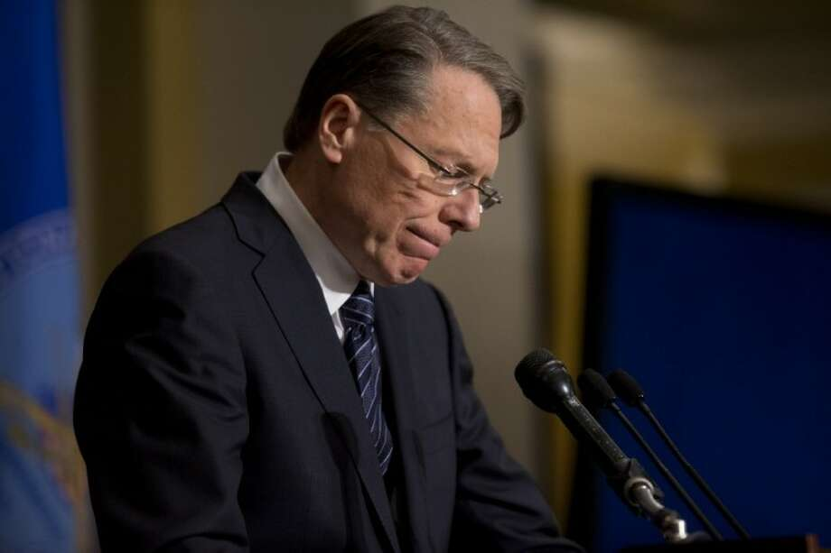 National Rifle Association executive vice president Wayne LaPierre pauses as he makes a statement during a news conference Friday in Washington. The National Rifle Association broke its silence on last week's shooting rampage. Photo: Evan Vucci