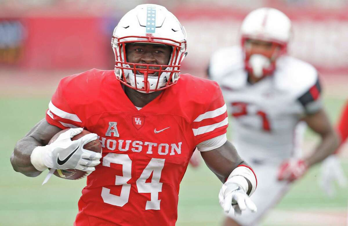 HOUSTON, TX - SEPTEMBER 10: Running back Mulbah Car #34 of the Houston Cougars rushes against the Lamar Cardinals in the second half at TDECU Stadium on September 10, 2016 in Houston, Texas. Houston won 42 to 0.
