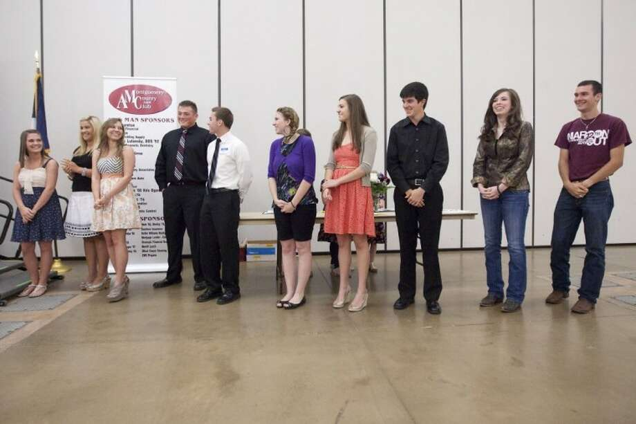 The 2012 recipients of the Montgomery County A&M Club scholarships are recognized during the Aggie Muster Saturday at the Lone Star Convention Center. Photo: Karl Anderson