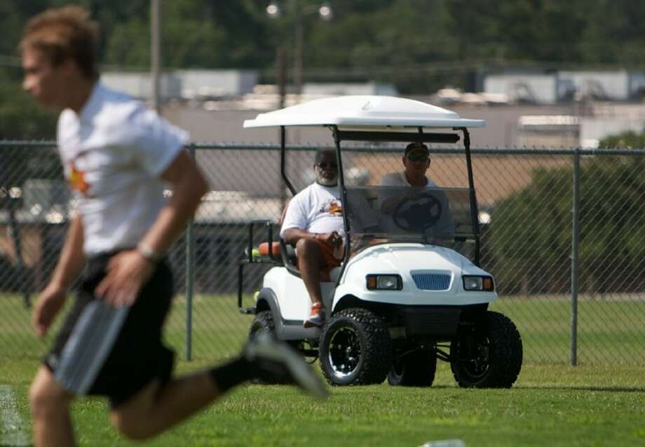 Earl Campbell looks on as young athletes participate in Saturday's football combine at Conroe High School. Photo: Staff Photo By Eric Swist