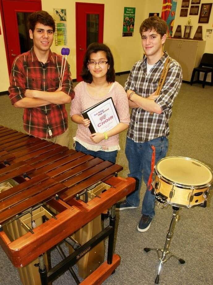 Oak Ridge High School is home to three musicians who earned a spot in the All-State Band and Choir. Pictured, from left, are Diego Reyes, percussionist; Liezelle Lopez, Soprano 2; and Nico Gonzalez, percussionist. Photo: Staff Photo By Kassia Micek