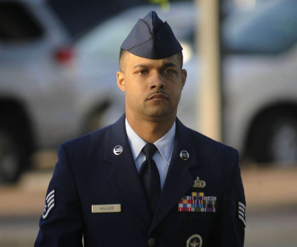 Air Force Staff Sgt. Luis Walker arrives for the fourth day of his trial at Lackland Air Force Base in San Antonio Friday.