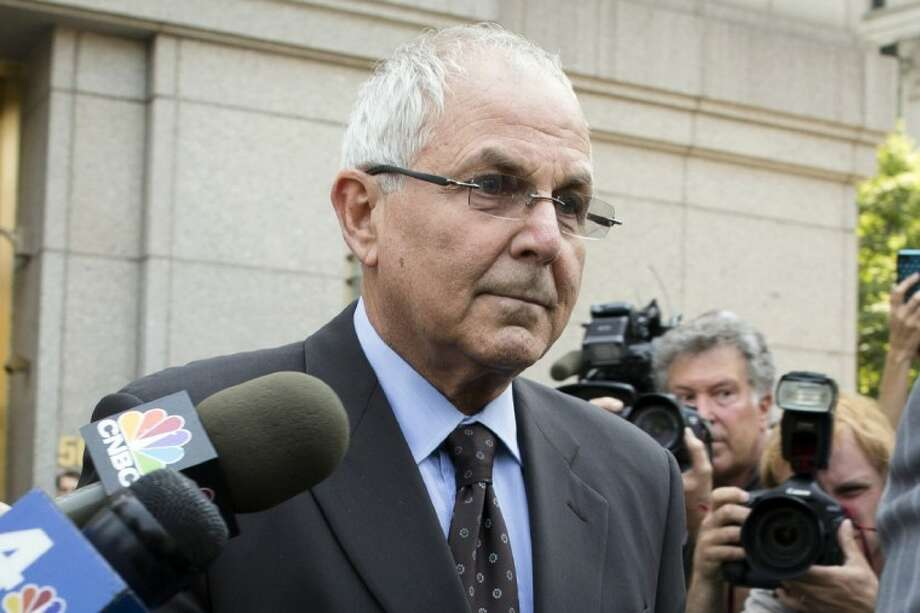Peter Madoff leaves Federal Court on Friday in New York after pleading guilty to criminal charges. Photo: John Minchillo
