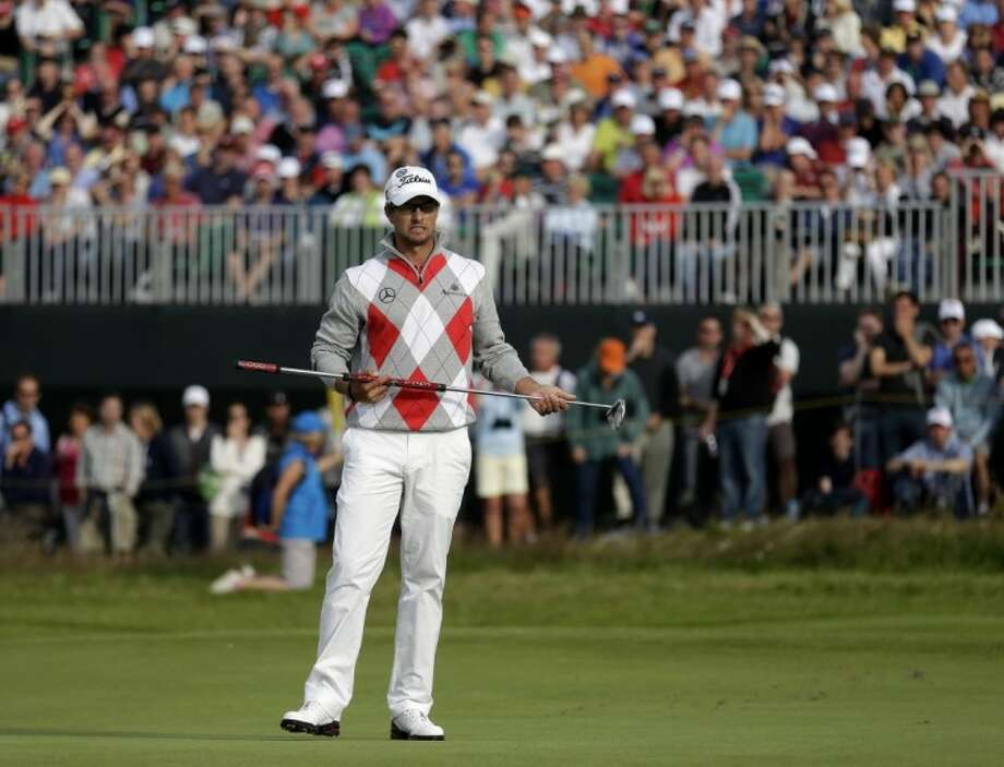 Adam Scott reacts after putting on the 15th green at Royal Lytham & St. Annes during the third round of the British Open on Saturday in Lytham St. Annes, England. Photo: Peter Morrison