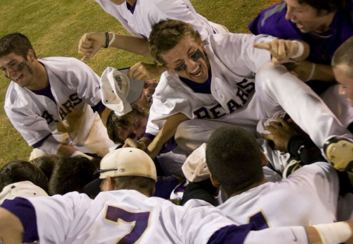 Montgomery players celebrate after defeating Lamar Consolidated 8-0 in Game 2 of the teams' best-of-three Region III-4A final series Thursday night at Langham Creek High School. With a sweep of the Mustangs, the Bears advanced to their second state tournament.