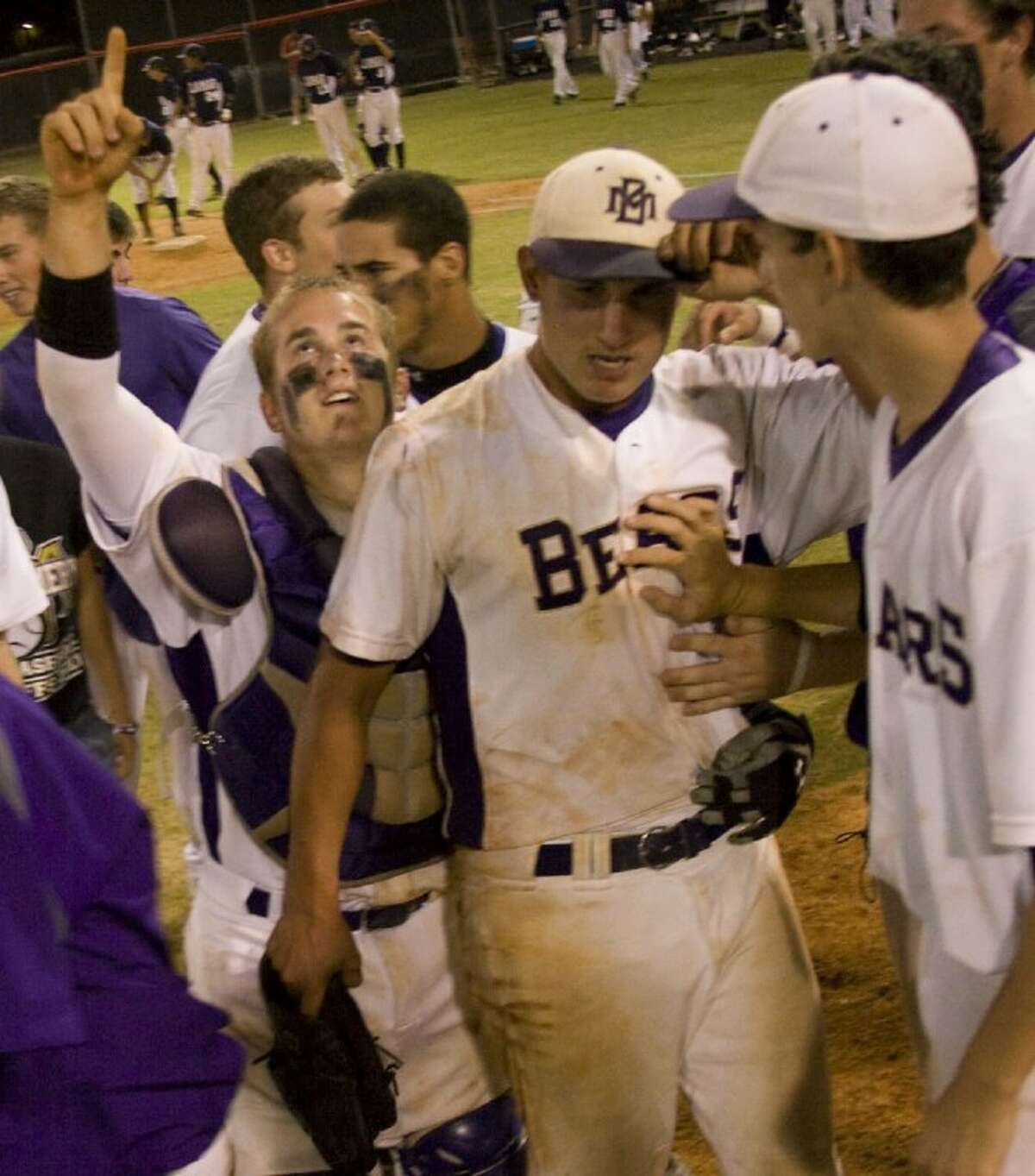 Montgomery catcher Cody Conn and pitcher Ty Boland come off the field after defeating Lamar Consolidated 8-0 on Thursday night at Langham Creek High School in Houston.