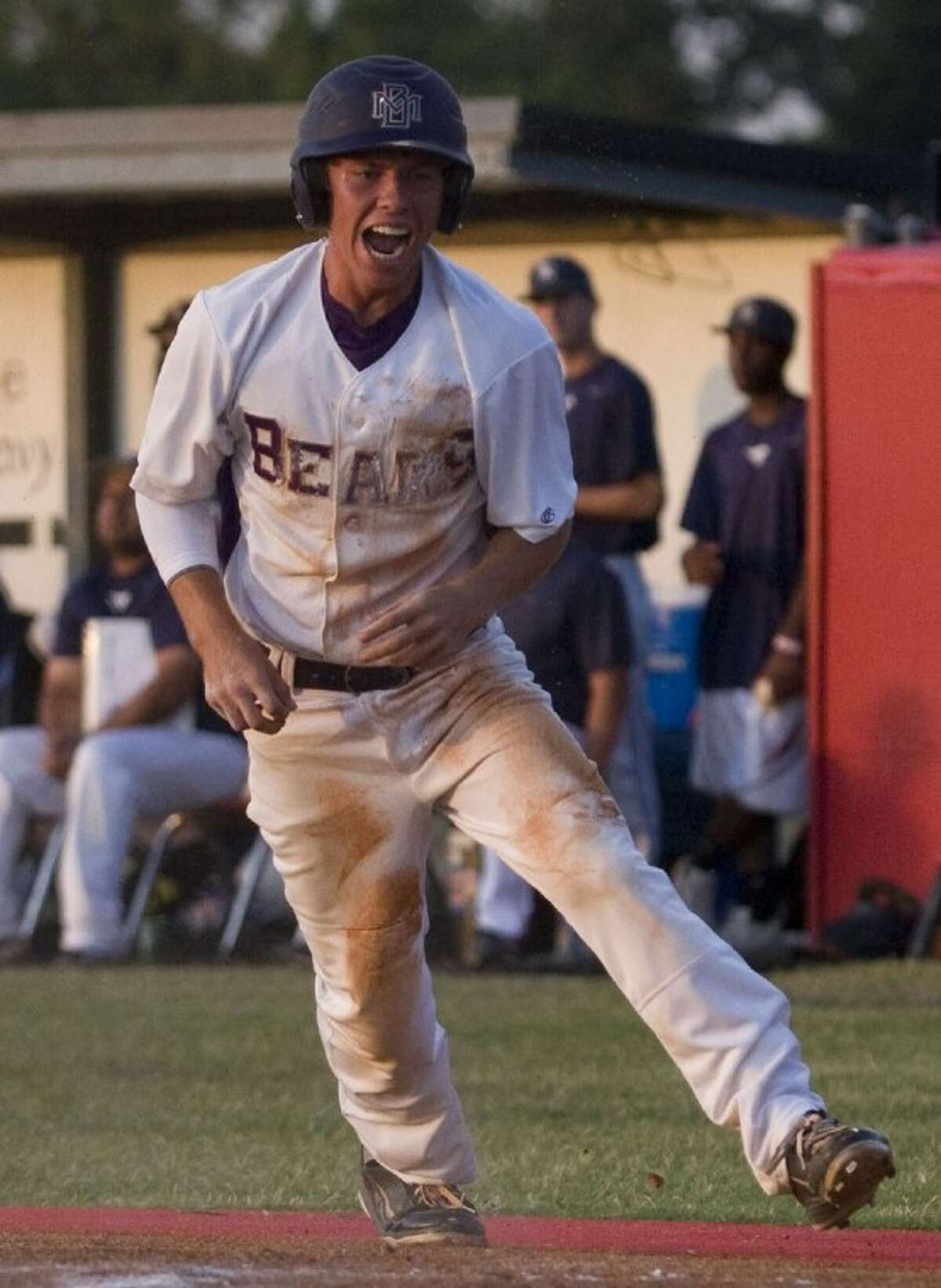 Montgomery's Cannon Landrum celebrates after scoring the Bears' first run on a sacrifice fly by pitcher Ty Boland in the third inning of Game 2 of the best-of-three Region III-4A final series against Lamar Consolidated last Thursday at Langham Creek High School.