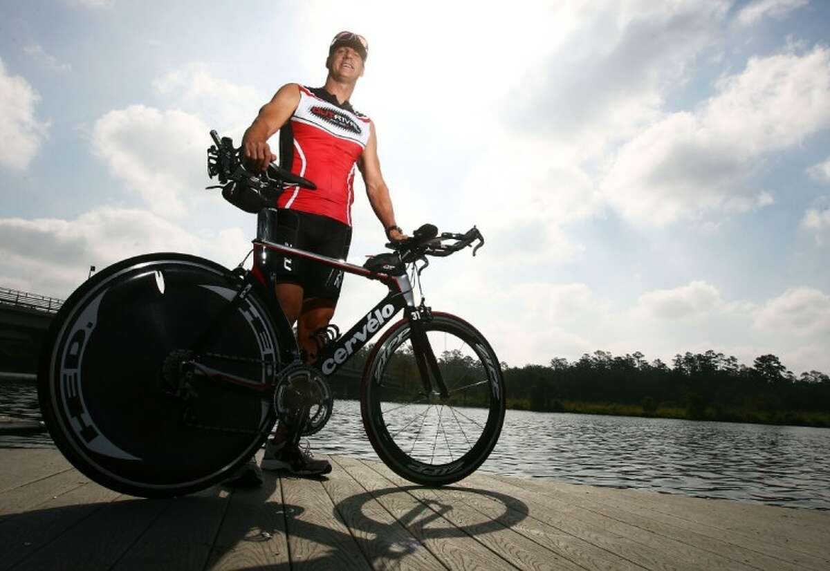 Former Navy SEAL Bob Maus, of The Woodlands, trains at Northshore Park on Sunday. Maus will be competing in his second Ironman triahlon Saturday.