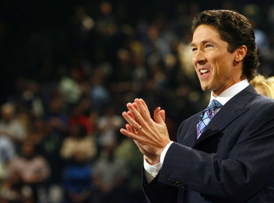 In a Sept. 30, 2007 file photo, Joel Osteen preaches during a worship service he leads with his wife, Victoria, at Lakewood Church, the congregation he took over eight years ago after the death of his father, John Osteen, founder of the institution. A stake in a yet-to-be-made movie about the life of Jesus Christ's mother with mega-preacher Joel Osteen of the Lakewood Church as executive producer could soon be held by the U.S. government. The plea deal that makes that happen could be a screenplay in itself. Photo: Steve Ueckert