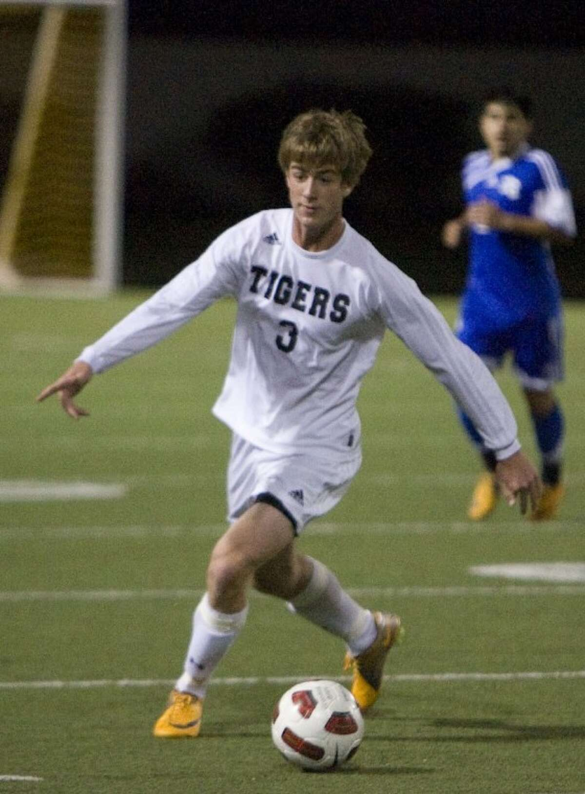 Conroe's Jonathan Cutaia dribbles downfield during Tuesday night's game against New Caney at Moorhead Stadium in Conroe.