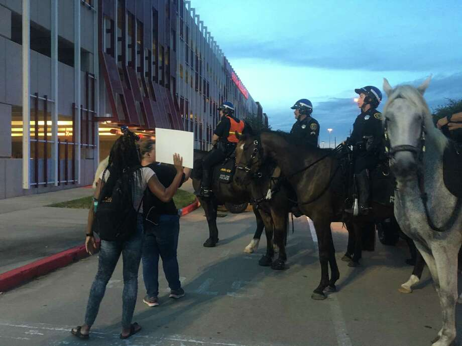 Protesters square off against mounted police in a parking lot during a Black Liver Matter event Saturday night. Photo: Keri Blakinger