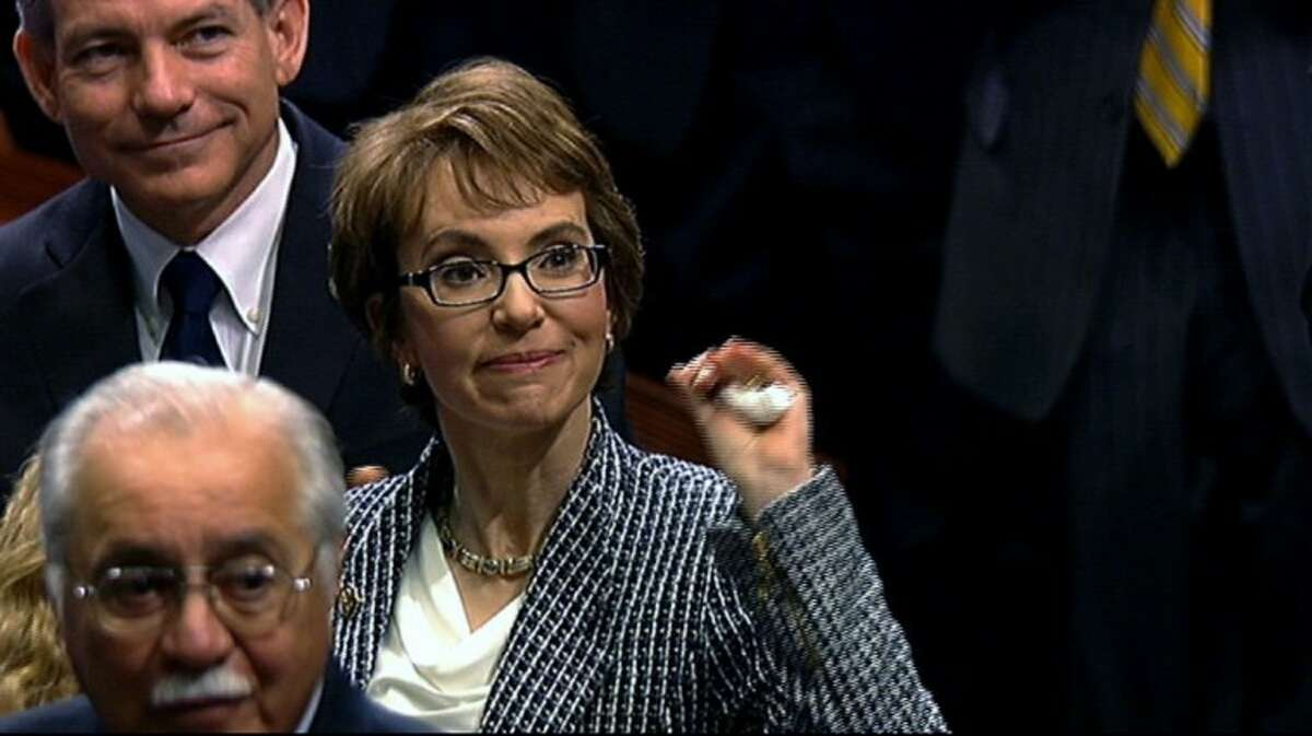 This video image provided by House Television shows Rep. Gabrielle Giffords, D-Ariz. on the floor of the House on Capitol Hill in Washington Wednesday. Giffords resigned from the House on Wednesday amid tears, tributes and standing ovations, more than a year after she was gravely wounded by a would-be assassin.