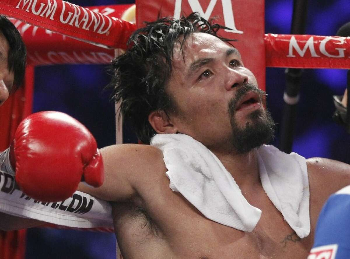 Manny Pacquiao sits in his corner following the eleventh round of his WBO welterweight title fight against Timothy Bradley, from Palm Springs, Calif., Saturday in Las Vegas. Bradley won the bout by split decision.