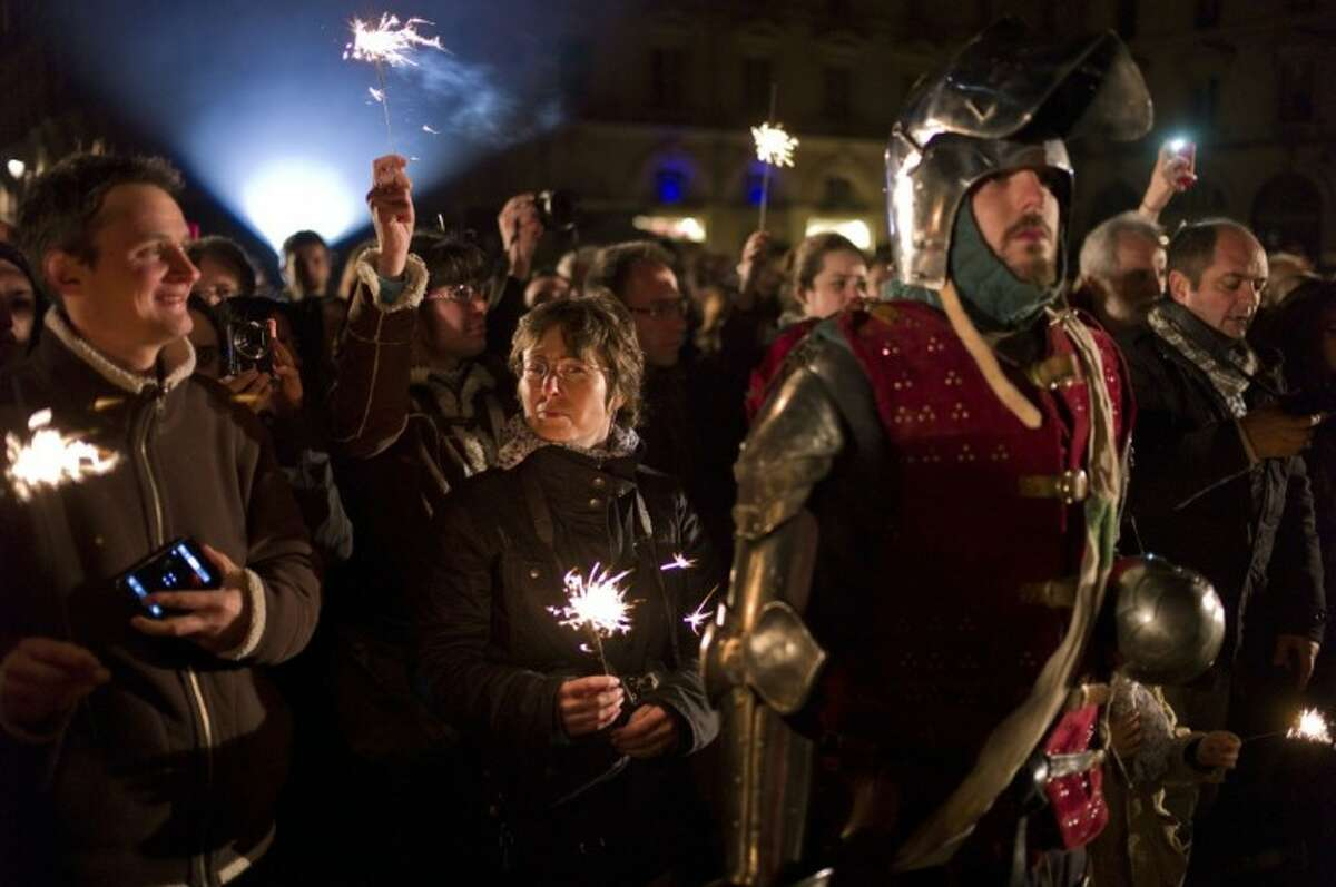 A man dressed like a Middle Age soldier attends ceremonies marking the 600th anniversary of the birth of Joan of Arc, in Orleans, central France, Sunday .