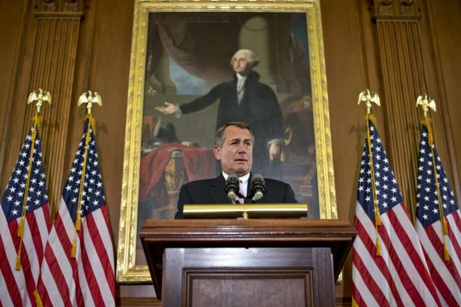 "In this Nov. 7 photo House Speaker John Boehner, R-Ohio, talks about the elections and the unfinished business of Congress at the Capitol in Washington. President Barack Obama is setting out to leverage his re-election into legislative success in an upcoming showdown with congressional Republicans over taxes, deficits and the impending ""fiscal cliff."" Boehner says Republicans are willing to consider some form of higher tax revenue as part of the solution _ but only under what he calls ""the right conditions."" Photo: J. Scott Applewhite"