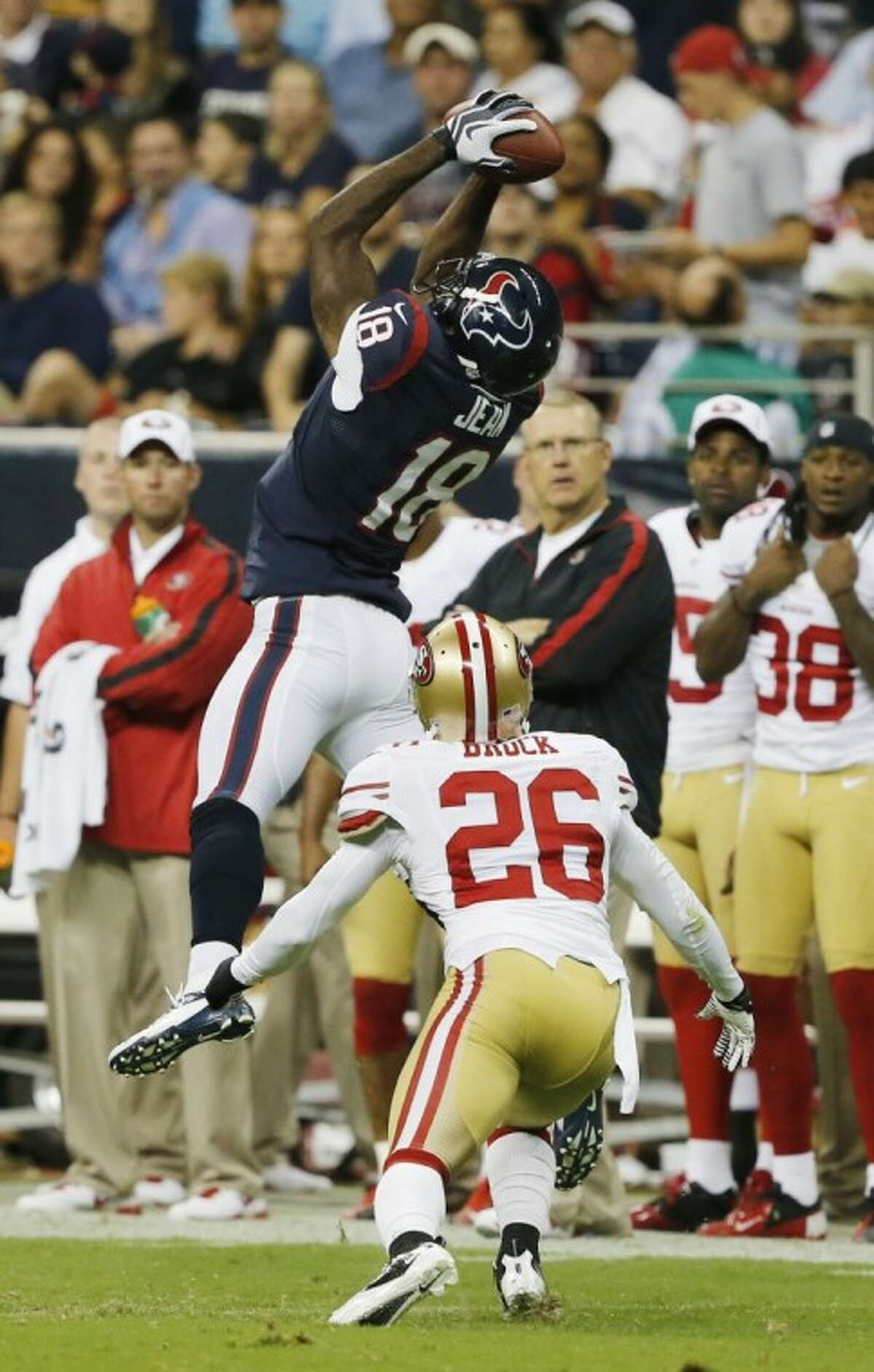 Houston Texans wide receiver Lestar Jean pulls down a 35-yard reception over the San Francisco 49ers' Tramaine Brock during the first half of Saturday's game in Houston.