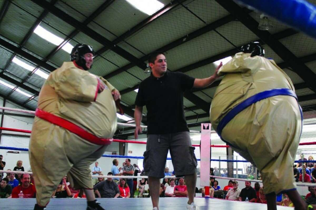 """At left, Rodney """"The Grape Crusher"""" Anderson, sponsored by Crescent Moon Wine Bar and fighting for New Danville, dons a sumo suit Saturday to spar against Ervin """"Black Mamba"""" Wes,t sponsored by Martini's & More and fighting for Light the Night."""