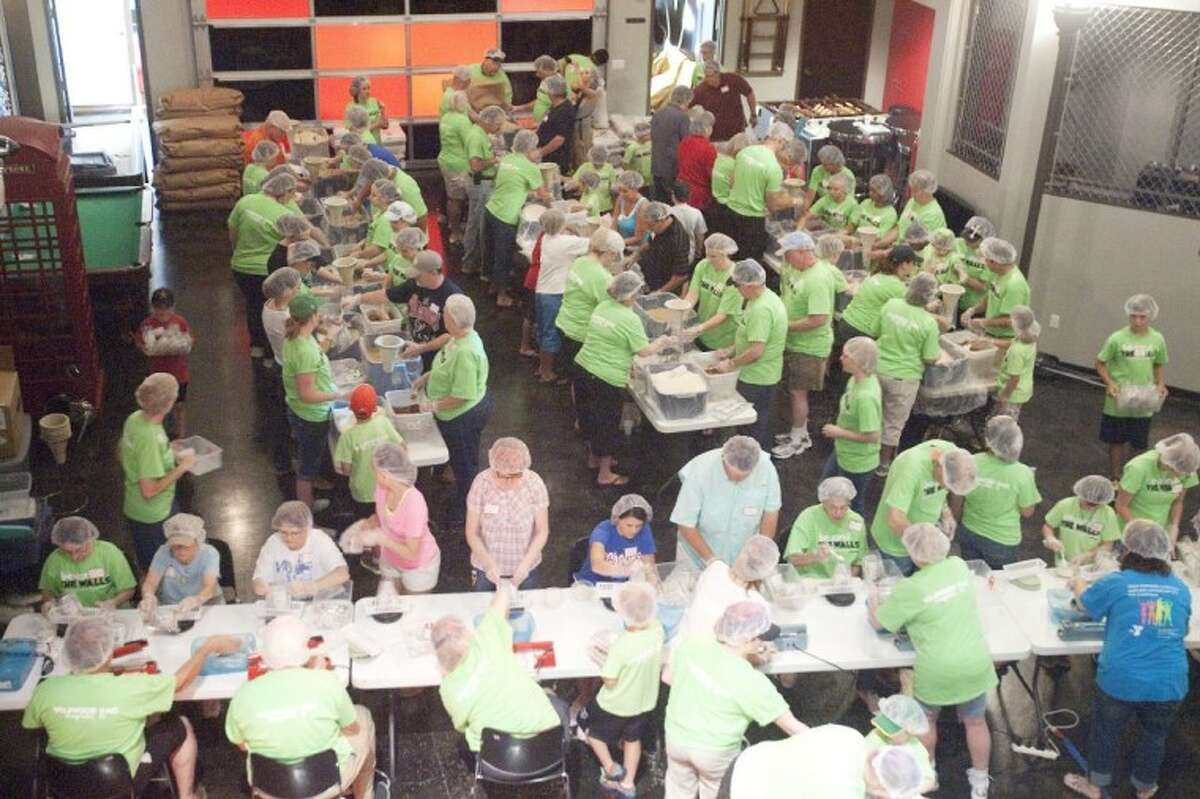 Volunteers pack meals for Stop Hunger Now to send to Africa and South America during the Beyond the Walls service day at Wildwood United Methodist Church in Magnolia.