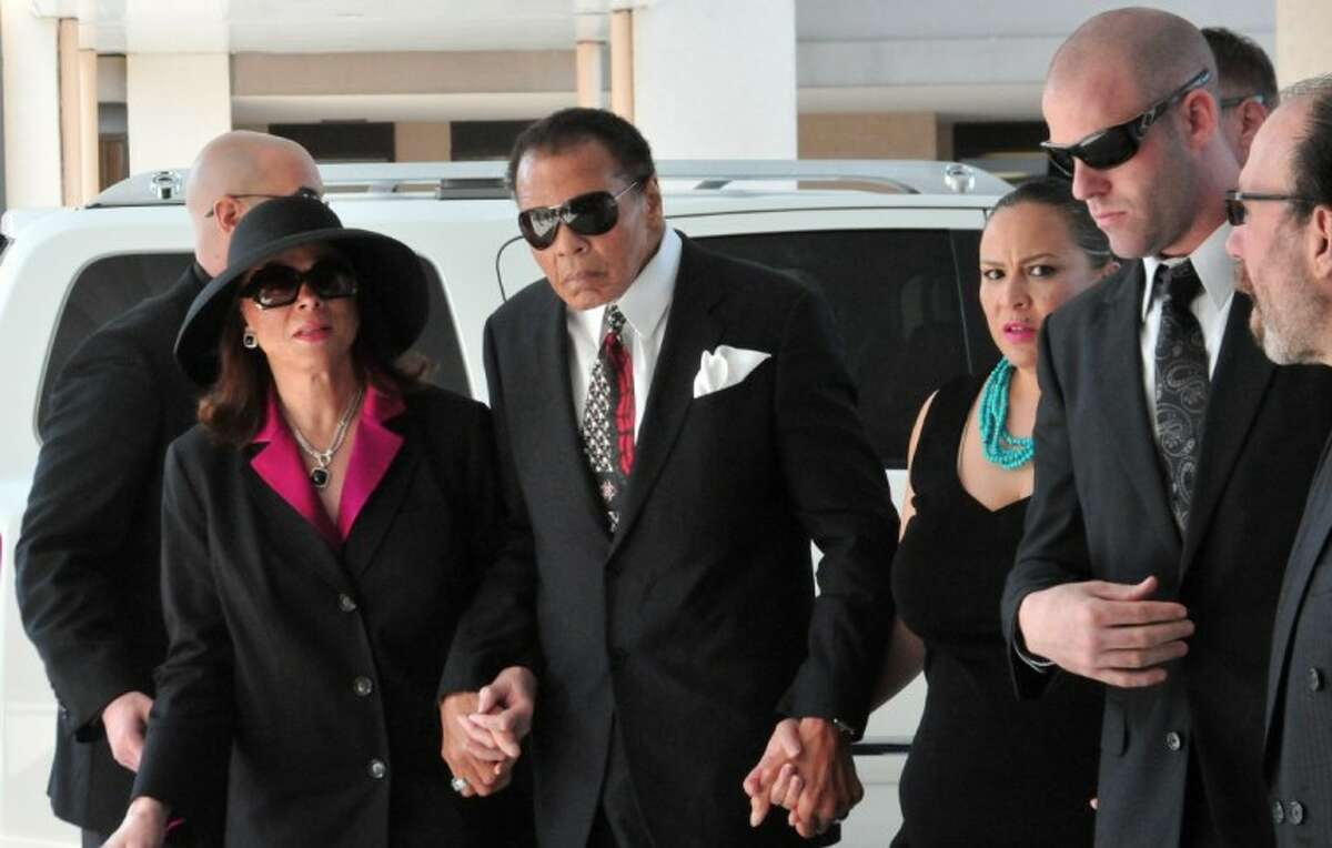 Muhammad Ali, center, and his wife, Lonnie, left, arrive for the funeral for legendary boxing trainer Angelo Dundee, at the Countryside Christian Center in Clearwater, Fla., Friday.