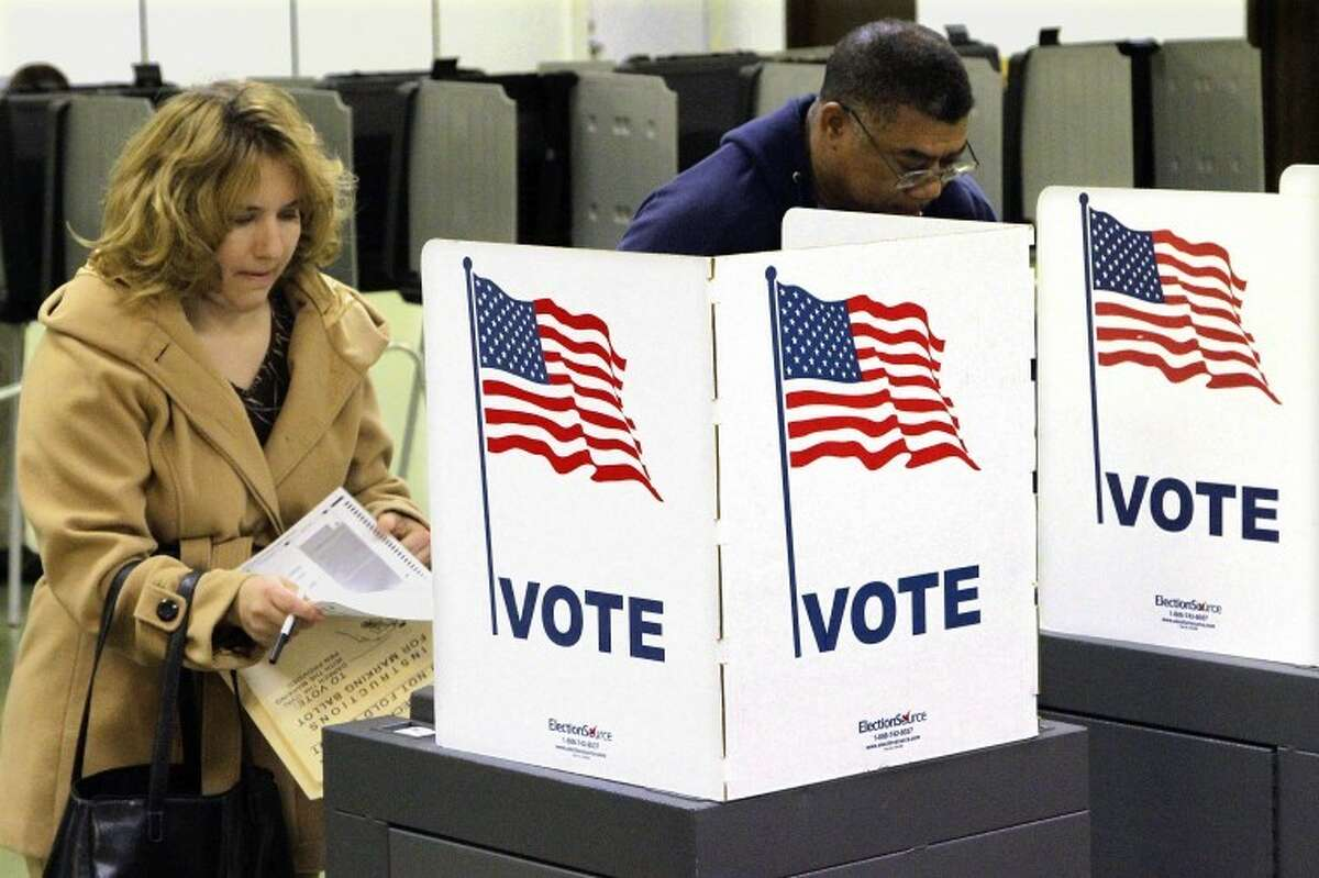 Voters cast their ballots on Election Day Tuesday, Nov. 6, 2012 in Riverton, Ill.