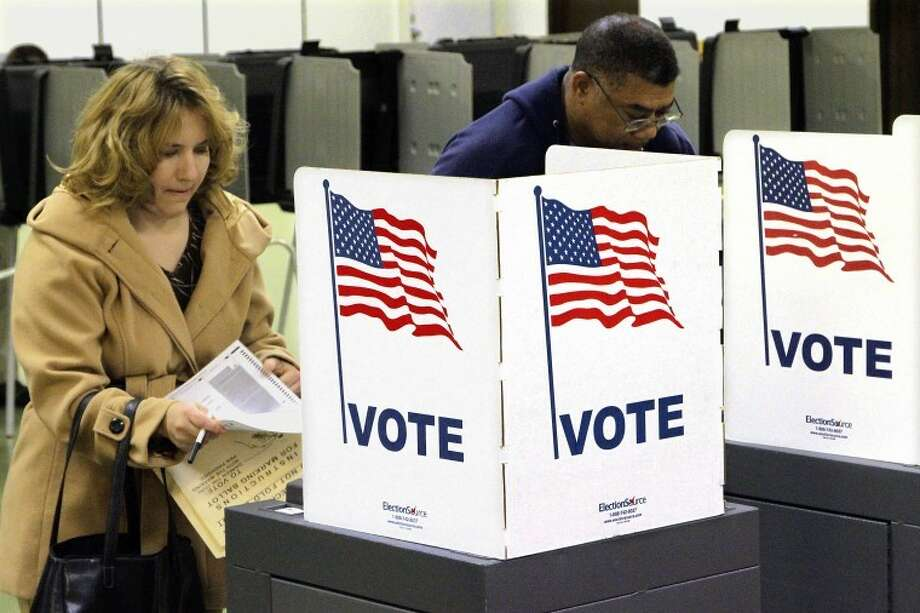 Voters cast their ballots on Election Day Tuesday, Nov. 6, 2012 in Riverton, Ill. Photo: AP Photo By Seth Perlman