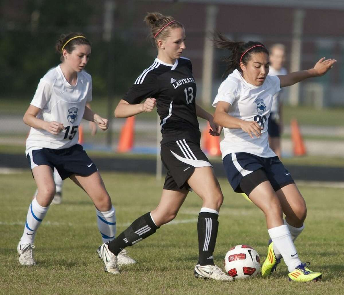 Tomball Memorial's Alex Gill tries to steal the ball from Willis' Emma Phillips Friday at College Park High School in The Woodlands. See more photos online at yourhoustonnews.mycapture.com.