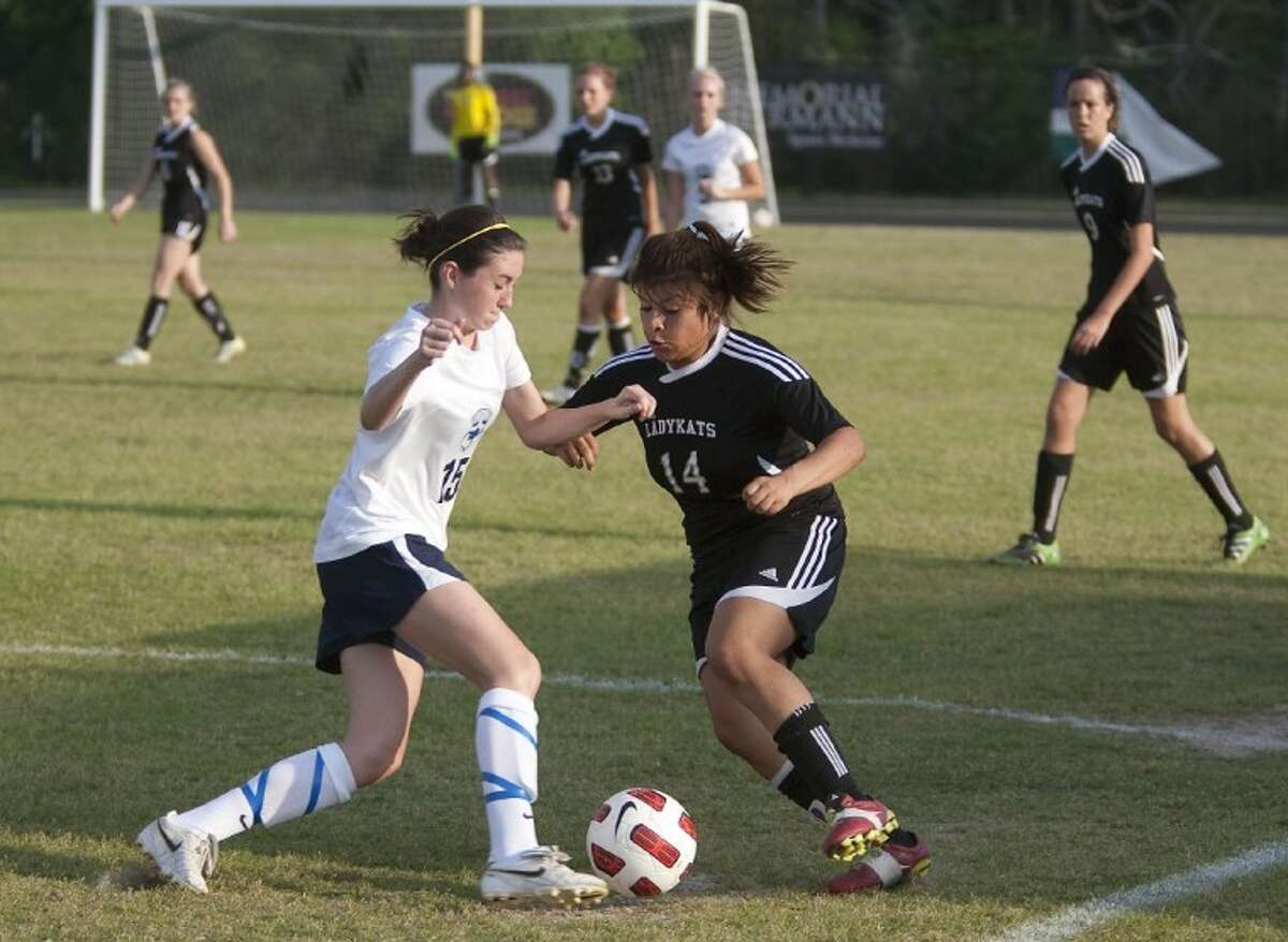 Tomball Memorial's Emily benton and Willis' Jasmine Perez fight for the ball Friday at College Park High School in The Woodlands. See more photos online at yourhoustonnews.mycapture.com.