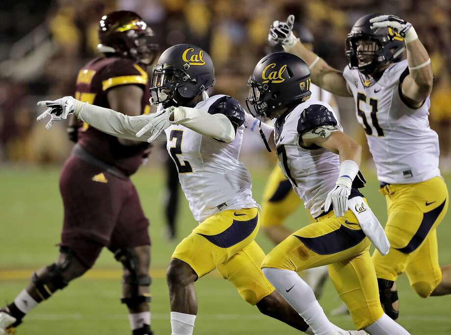 California cornerback Darius Allensworth (2) celebrates his interception with teammate Hamilton Anoa'i (11), during the first half against Arizona State in an NCAA college football game, Saturday, Sept. 24, 2016, in Tempe, Ariz. (AP Photo/Matt York) Photo: Matt York, Associated Press