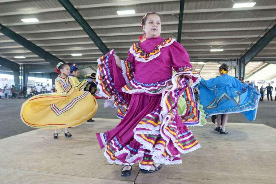 """Grupo Danza Olliquctzali performs to the song """"Jalisco"""" during the final day of the Montgomery County Fair and Rodeo on Sunday. Photo: Karl Anderson"""