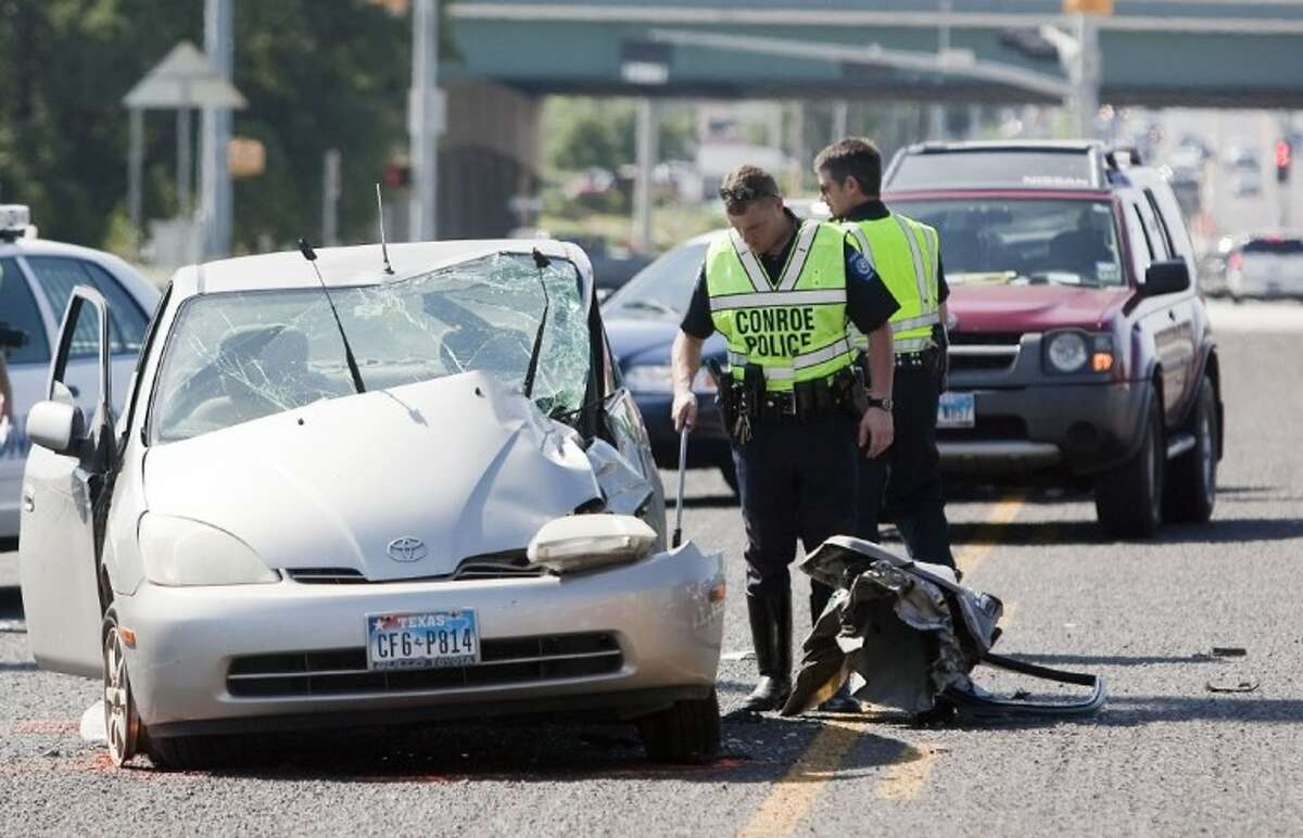 Conroe Police investigate a fatal traffic wreck at 900 West Davis Street, just east of I-45 on Saturday.
