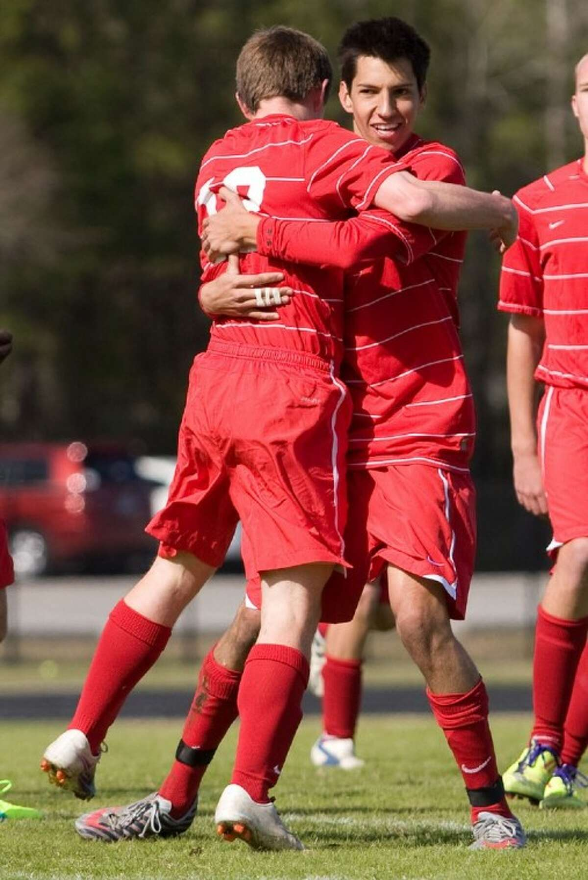 The Woodlands' Andrew Larson, left, and Santi Navas celebrate after Navas' goal early in the first half against Spring on Thursday at the Kilt Cup at The Woodlands High School.