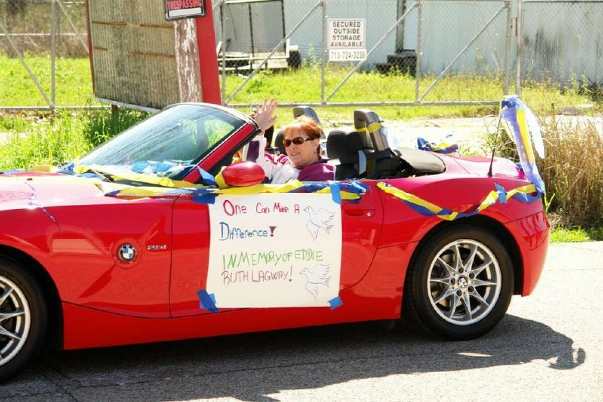 A woman drives a car honoring Eddie Ruth Lagway in Saturday's Project Hope Black history Parade in Conroe. Lagway, who died on Jan. 12, owned Lagway Bail Bonds and was an active member in the Willis community. She was honored at the parade and at the ceremony afterward.