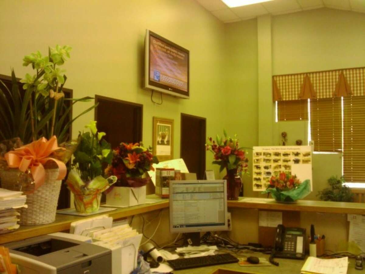 Flowers from sympathizers adorn the front desk of the Veterinary Medical Center of Spring. Karen Gunn said in her Facebook page that her work as a veterinarian was her true passion.