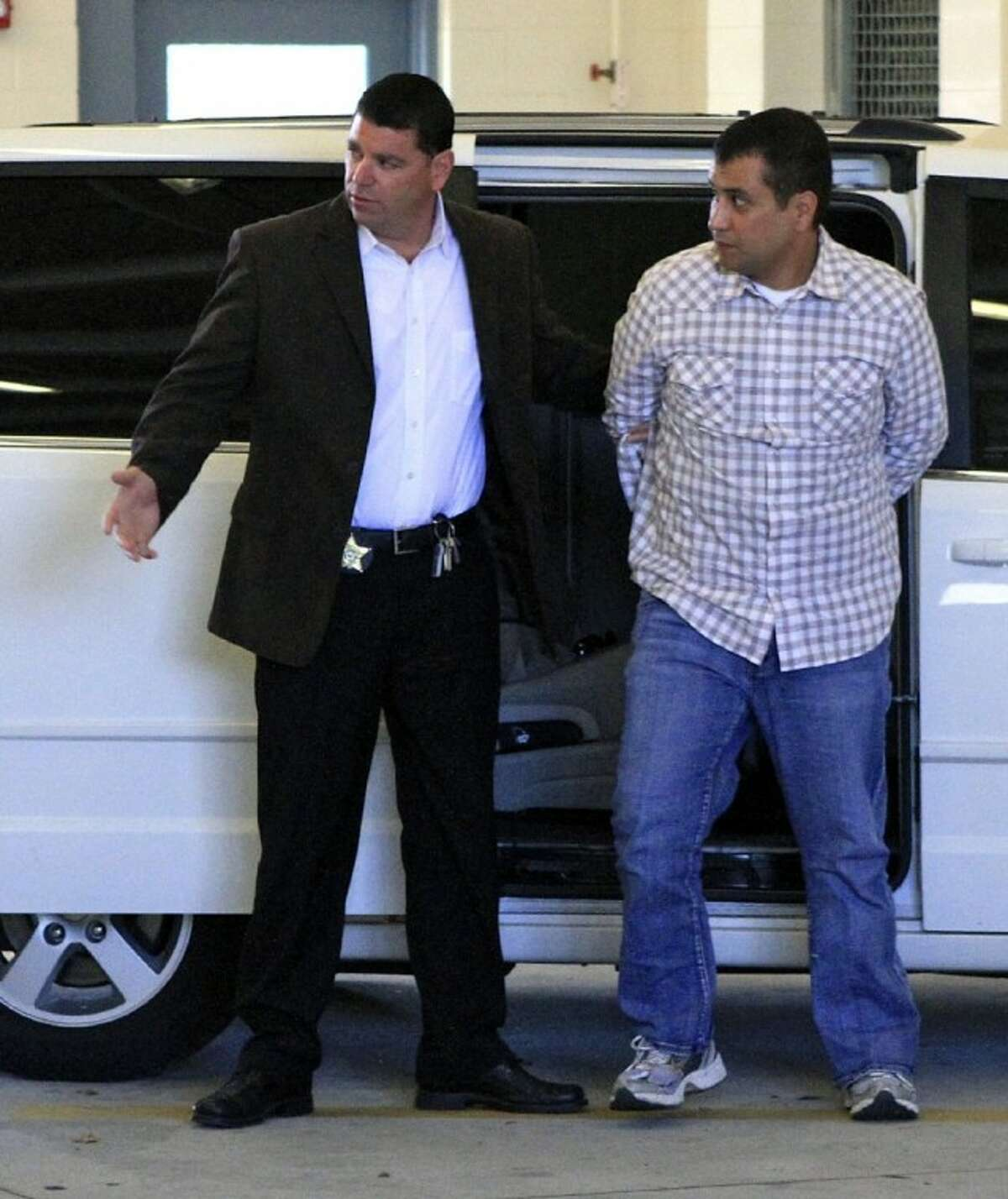 After his bond was revoked, George Zimmerman, right, returns to the John E. Polk Correctional Facility in Sanford, Fla., Sunday. Zimmerman is charged with second-degree murder in the shooting of Trayvon Martin.