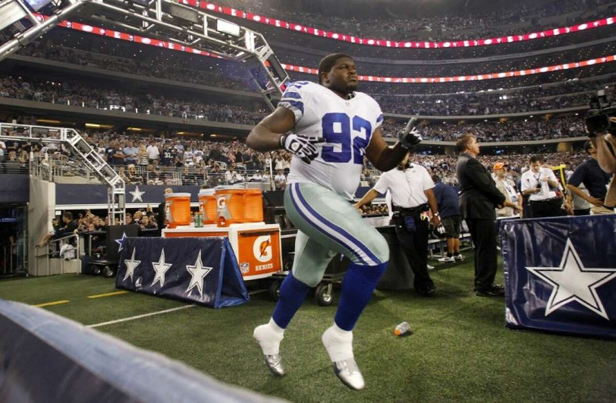 In this Sunday, Dec. 2, 2012, photo, Dallas Cowboys nose tackle Josh Brent runs onto the field out of the team's tunnel after being introduced before an NFL football game against the Philadelphia Eagles in Arlington, Texas. Brent is facing an intoxication manslaughter charge after a one-vehicle accident that killed linebacker Jerry Brown, a member of the team's practice squad.
