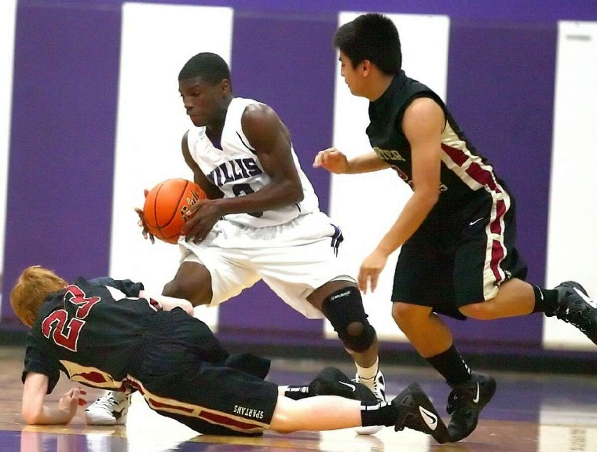 Willis' Anthony Nixon steals the ball during the game against Porter Friday at Willis High School. See more photos online at www.yourconroenews.com/photos.