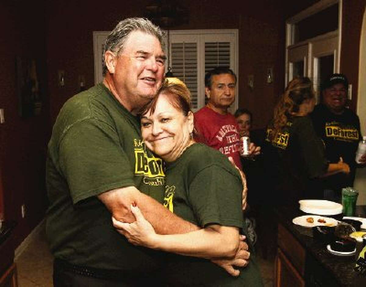 Incumbent Precinct 2 Constable Gene DeForest receives a victory hug from his wife Eva following his victory over challenger David Moore Tuesday night