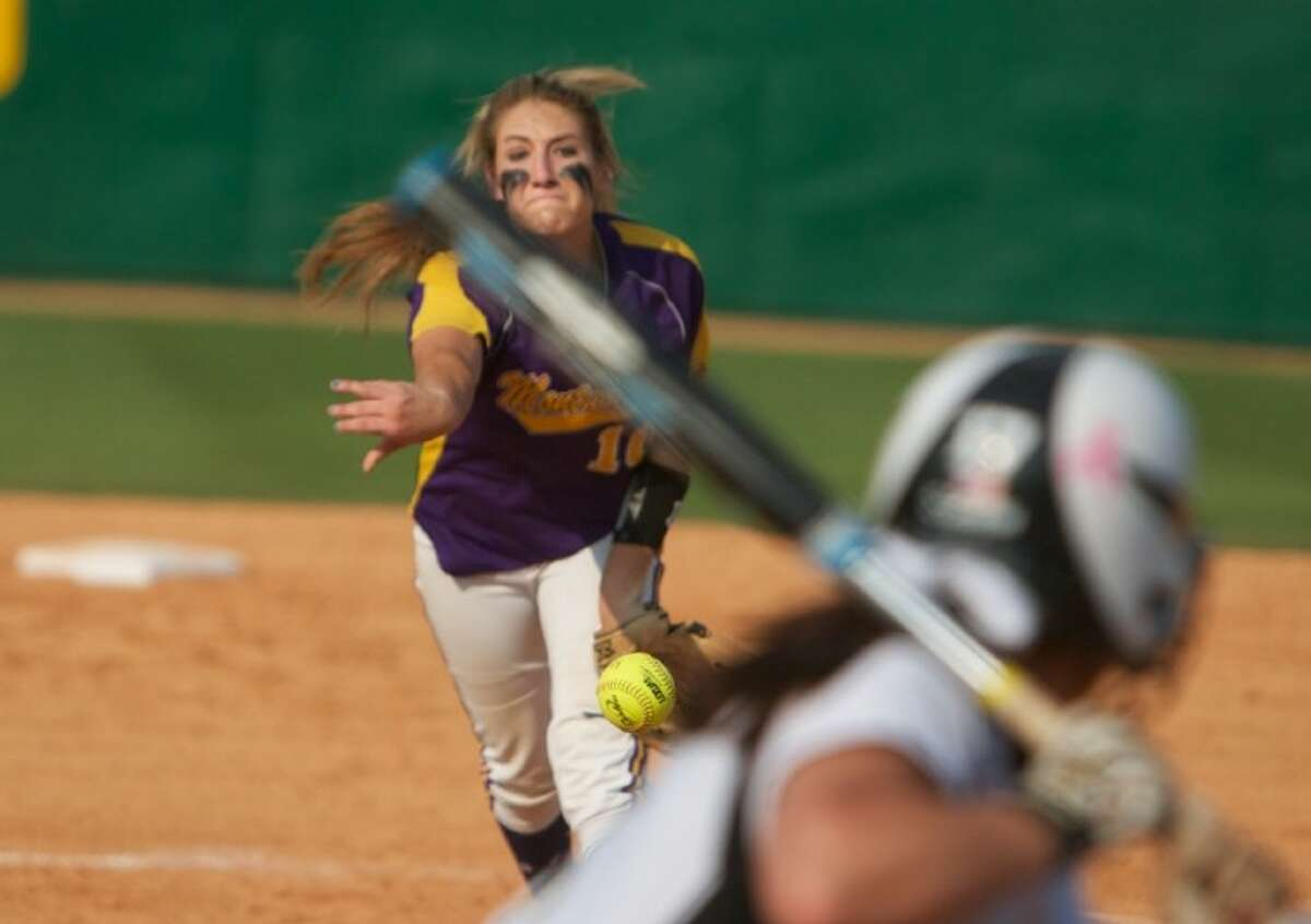 Montgomery's Katelyn Sanders fires off a pitch during Saturday's Region III-4A playoff game against Nederland.