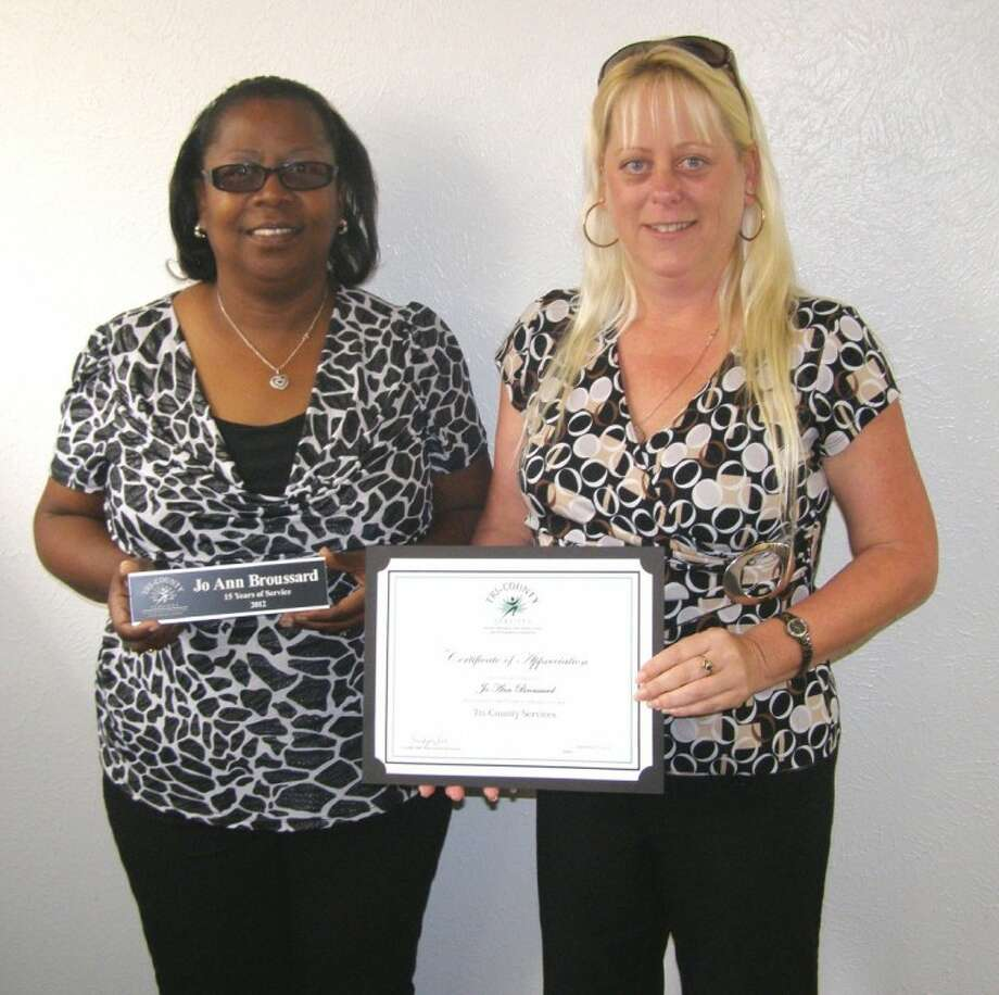 Jo Ann Broussard, left, with Supervisor Yevonne Farrar, was honored for her 15 years of service with Tri-County Services.