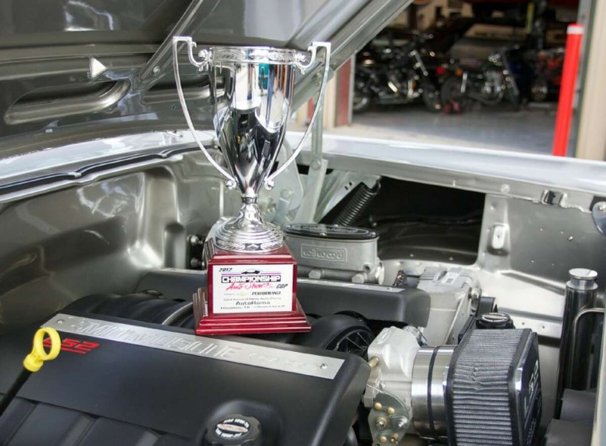 Rob Bryngelson's 1957 Chevy received a championship trophy at Houston Autorama. Mo's Muscle Cars restored the classic car for Bryngelson.