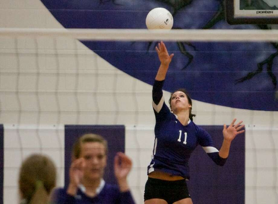 Willis' Hope Pawlik goes up to serve during Tuesday night's game against Brenham. Photo: Staff Photo By Eric Swist