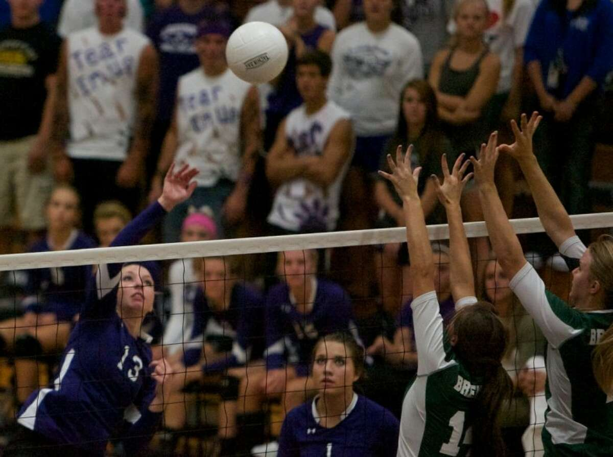 Willis High School's Tanis Scott goes up for a spike during Tuesday night's District 18-4A match against Brenham.