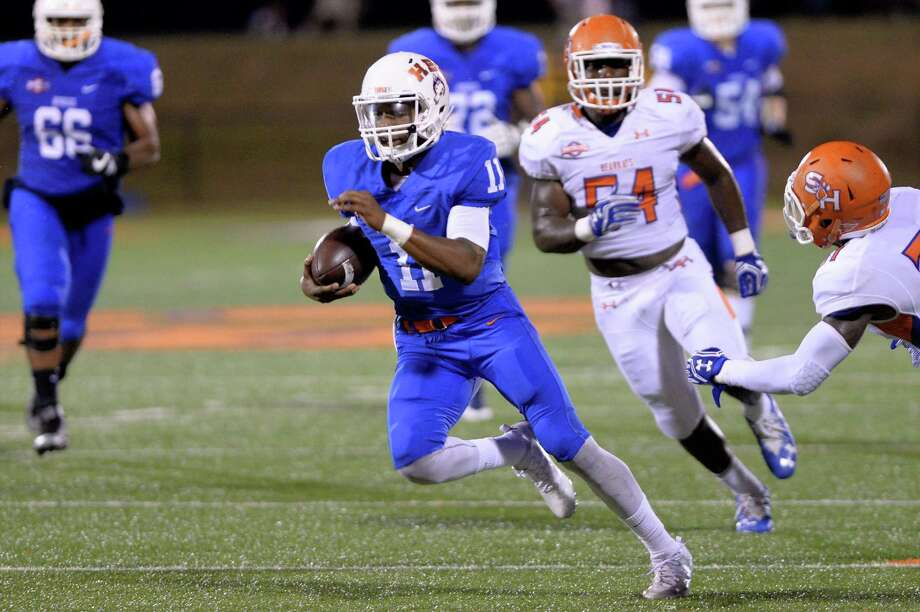 Houston Baptist quarterback Tony Dawson (11) set up a field goal with this run during the second quarter of Saturday's game against Sam Houston State. Photo: Craig Moseley, Staff / ©2016 Houston Chronicle