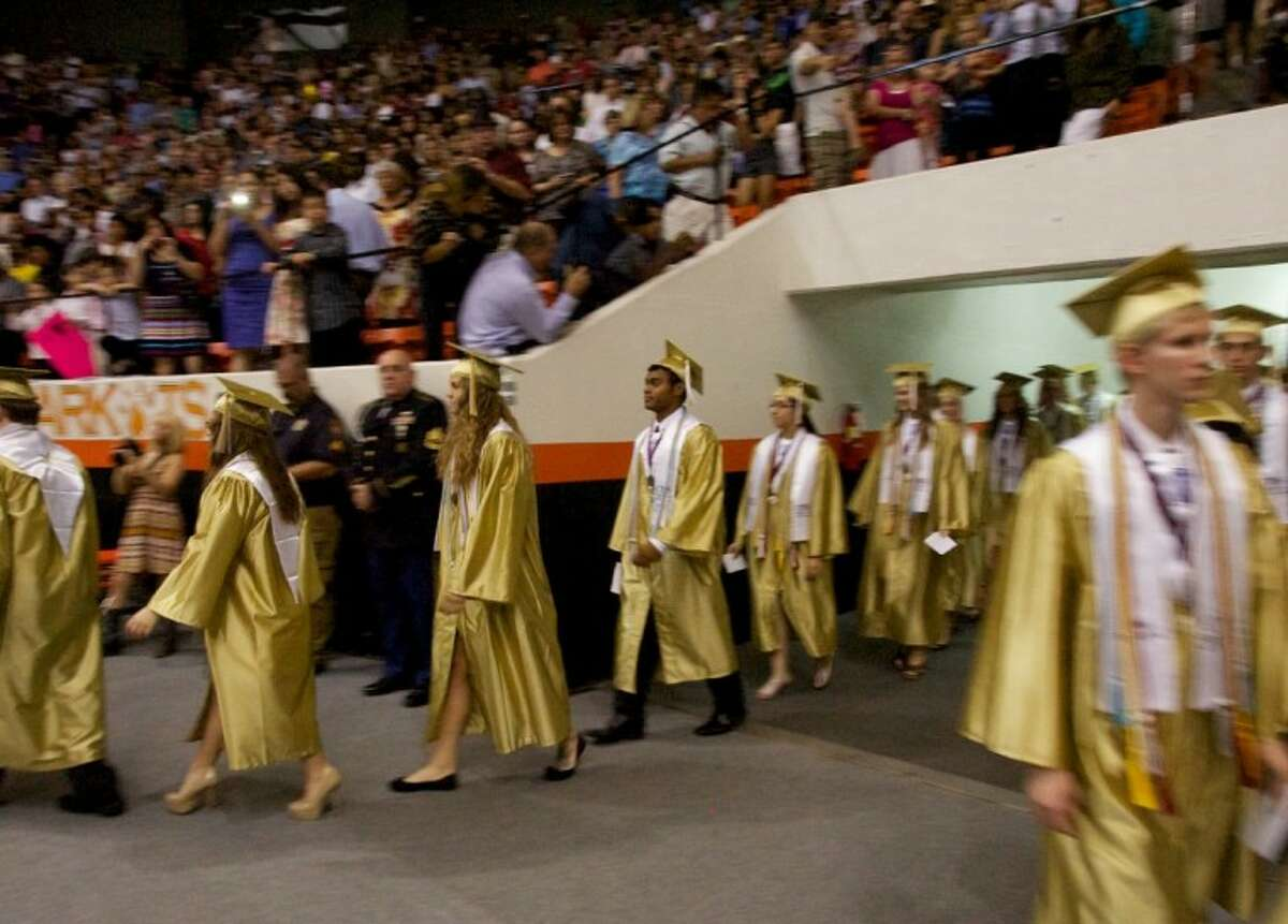Conroe High School students enter the Johnson Coliseum for Saturday's commencement address in Huntsville.