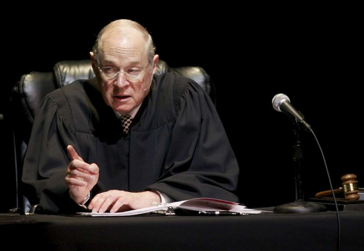 """In this Jan. 31, 2011, file photo, U.S. Supreme Court Justice Anthony Kennedy presides over a representation of """"The Trial of Hamlet"""" at the Shakespeare Center of Los Angeles. During Supreme Court arguments last week over the constitutionality of the health care law, Justice Kennedy mused that Congress could have created a Medicare-style program for the uninsured, run exclusively by the government without the involvement of private insurers."""