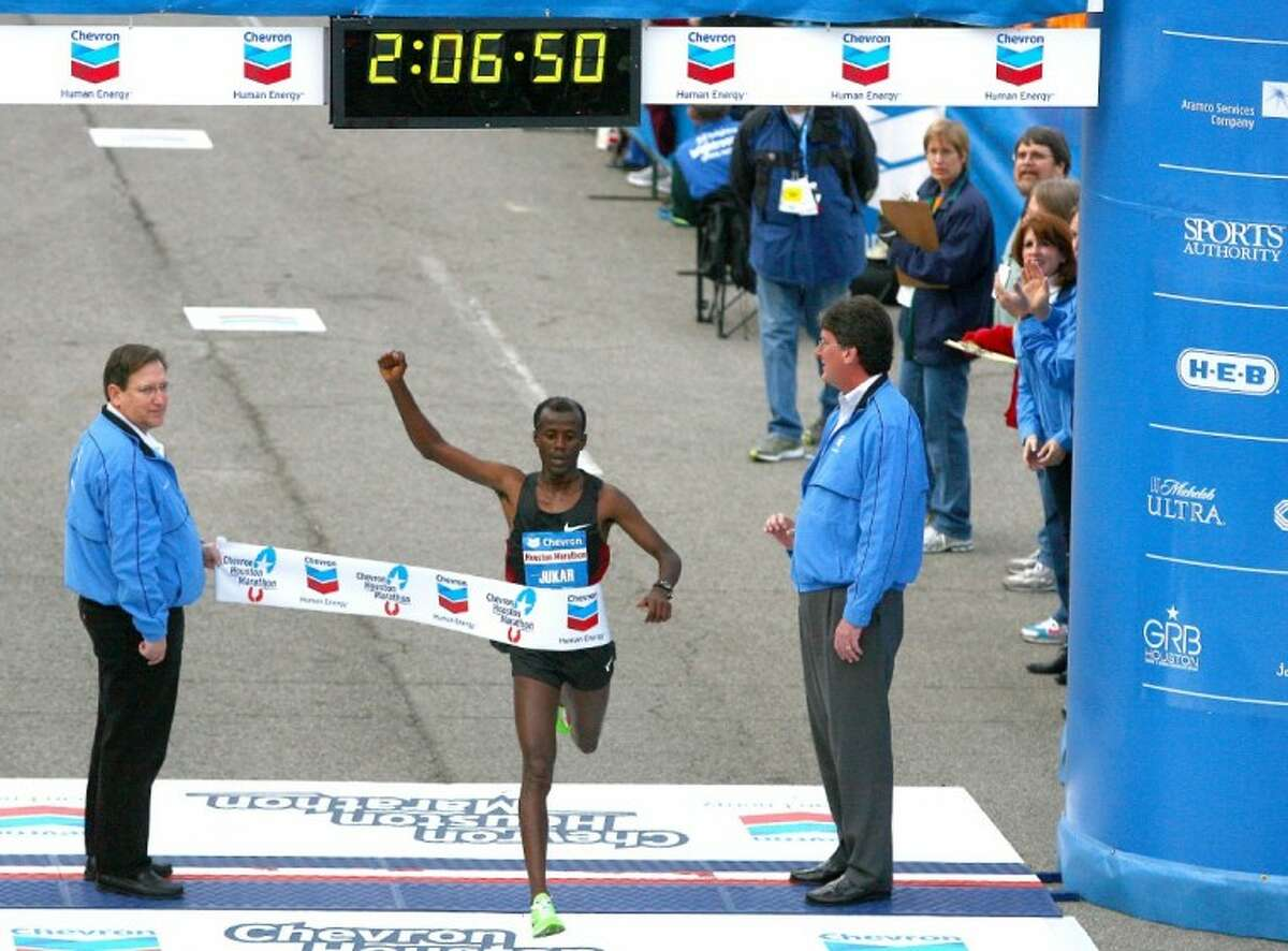 Tarika Jufar, of Ethiopia, crosses the finish line Sunday to win the men's division of the Chevron Houston Marathon with a time of two hours, six minutes and 51 seconds.