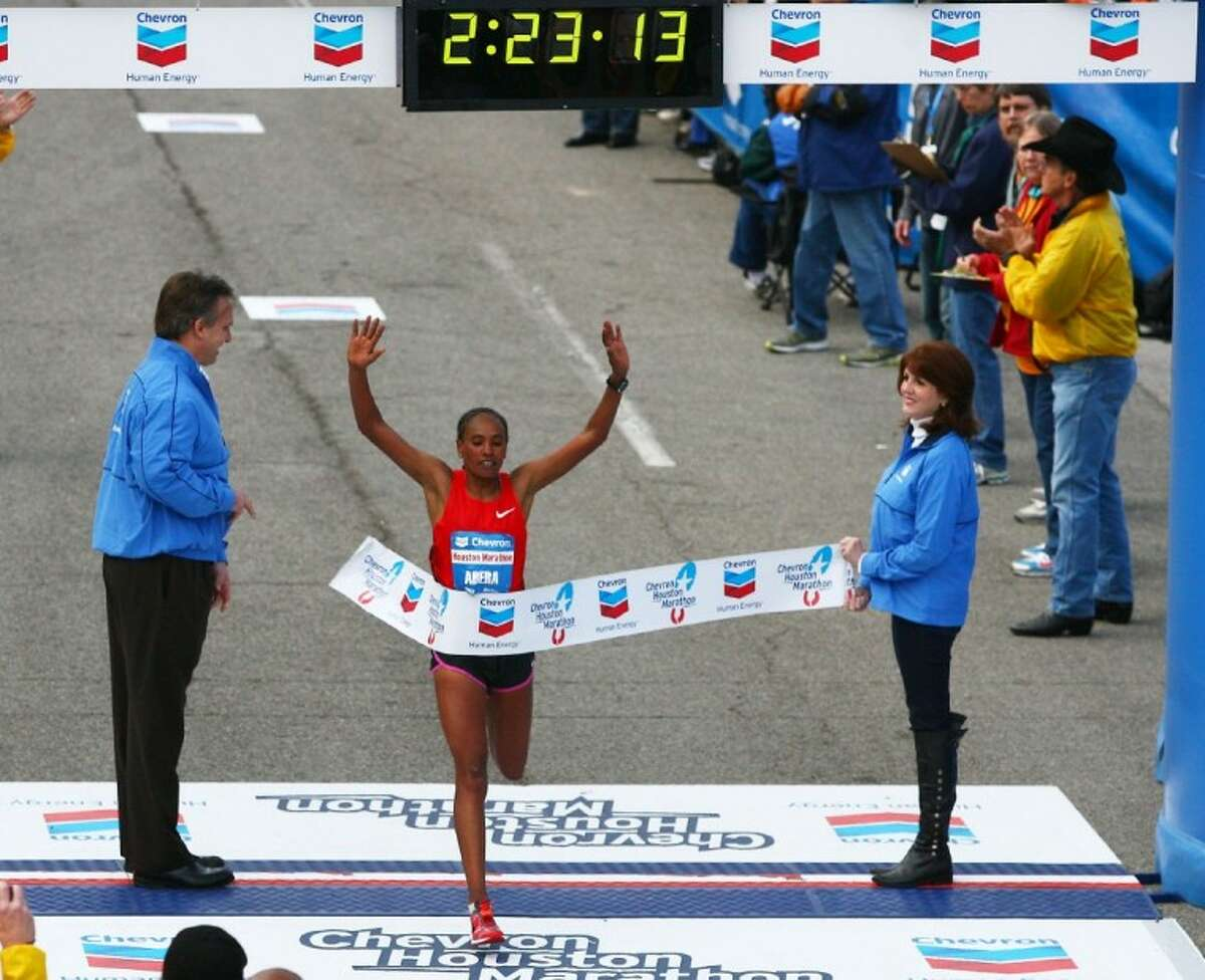 Alemitu Abera, of Ethiopia, crosses the finish line Sunday to win the women's division of the Chevron Houston Marathon with a time of two hours, 23 minutes and 14 seconds. seconds.